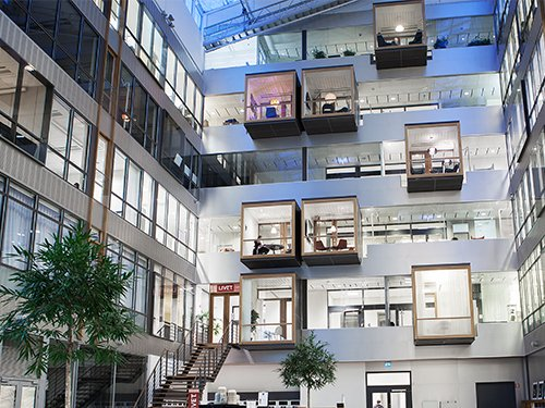 Workplace with offices shaped like cubes hanging from the wall | Coor